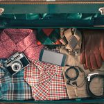 Packed Hipster Suitcase