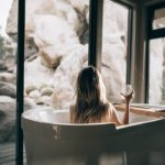 woman vacation tub with wine