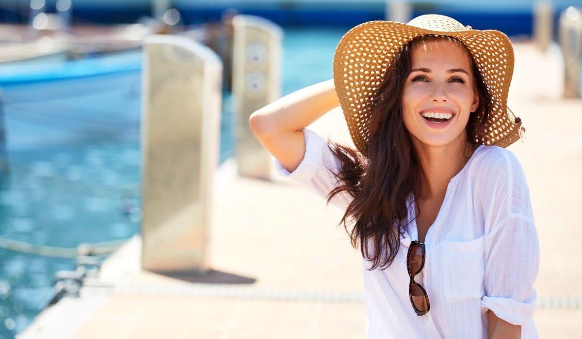 happy woman poolside