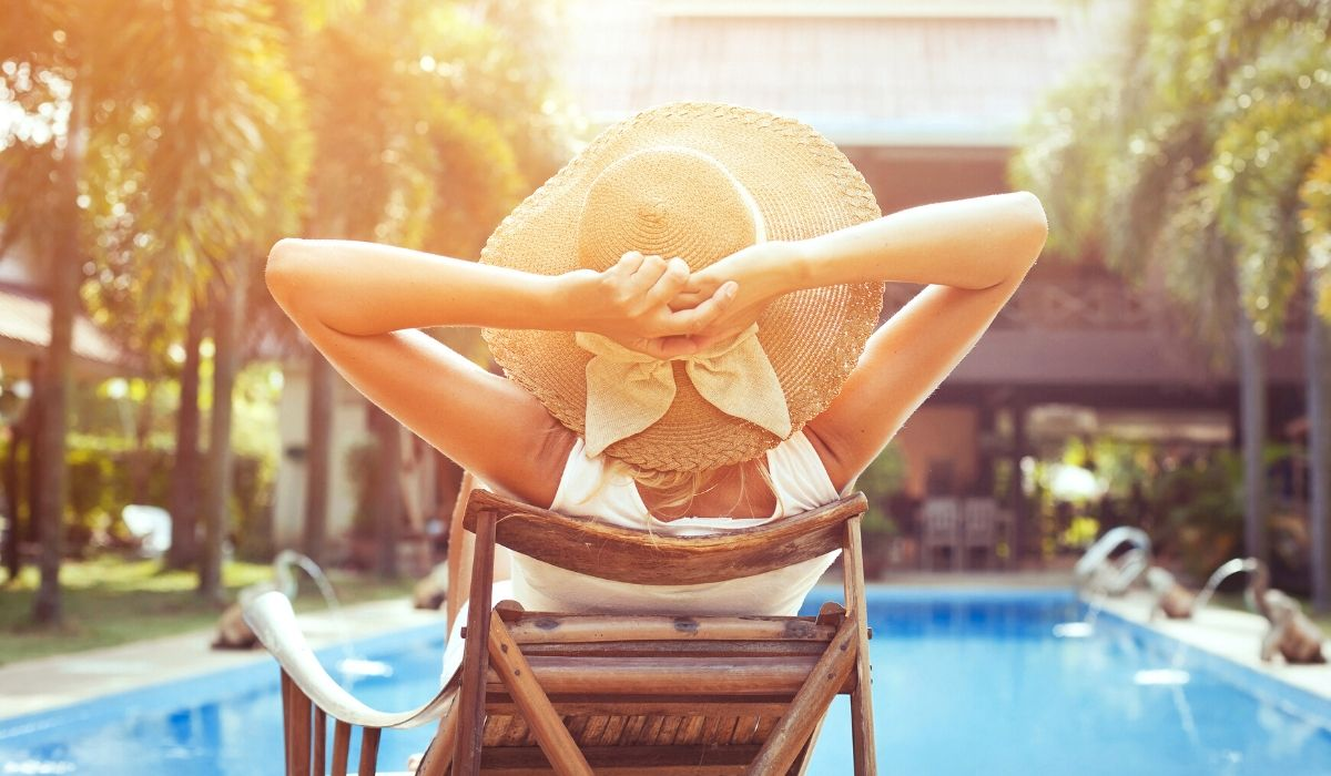 woman lounging poolside