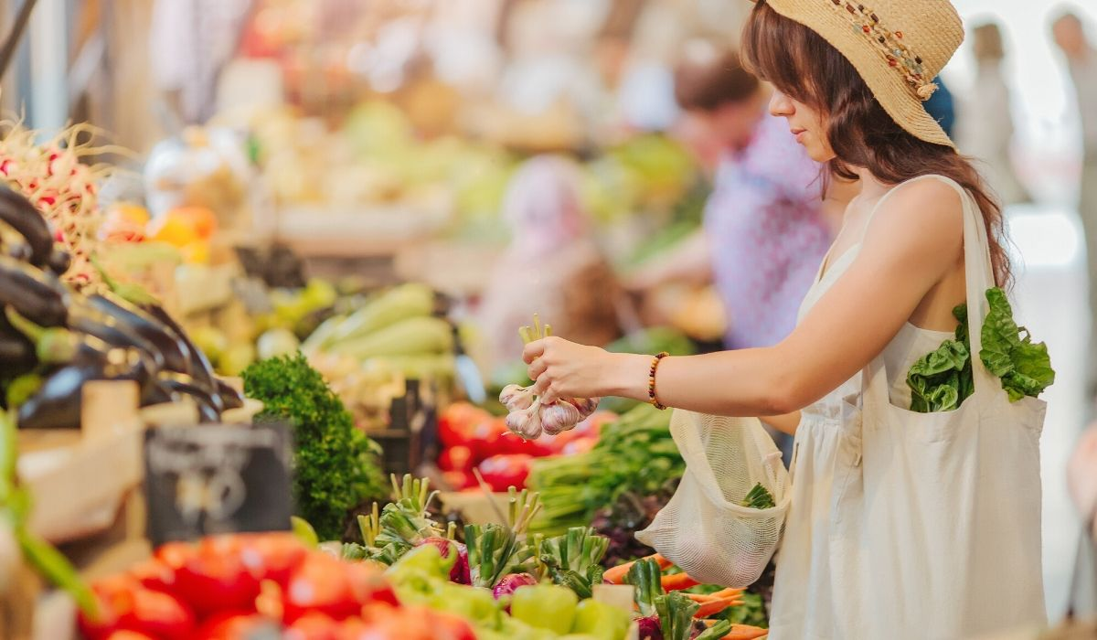 choosing produce at market