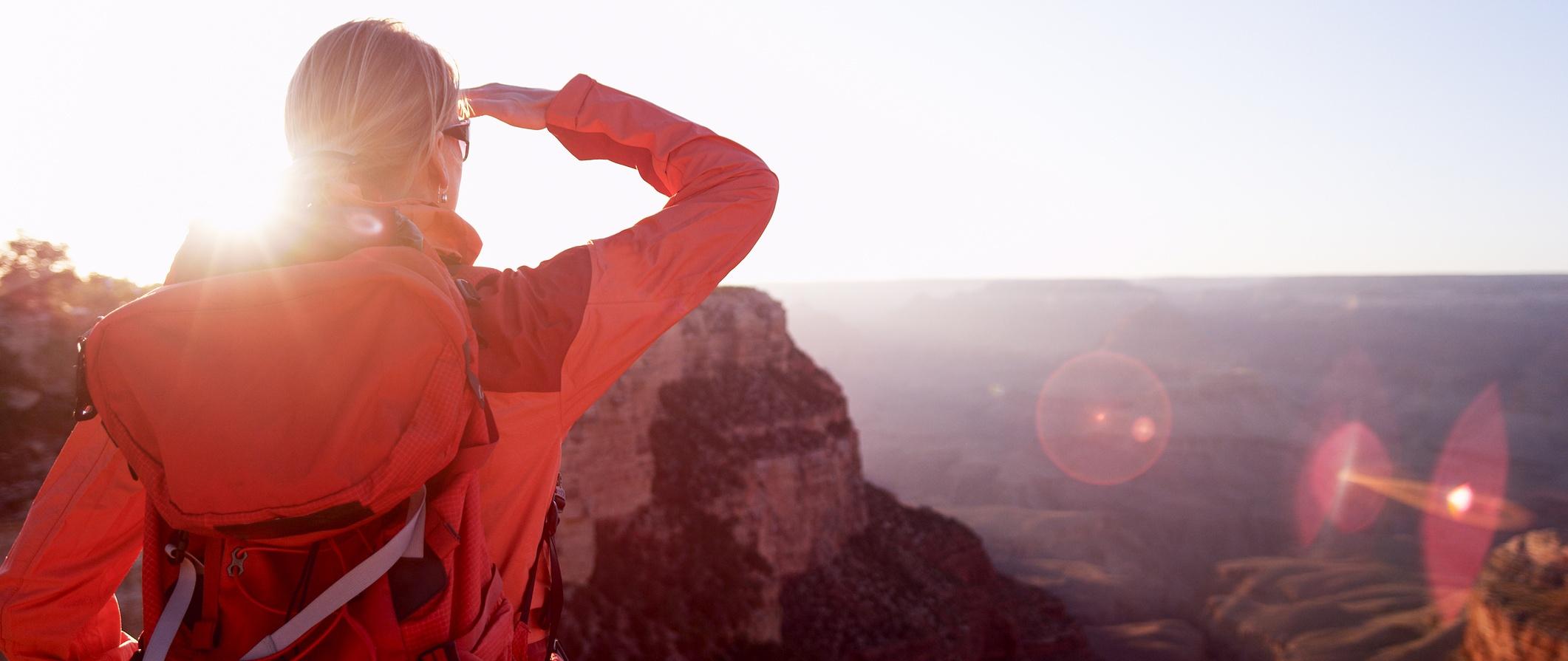 A woman hiker looking at the Grand Canyon, Arizona, USA