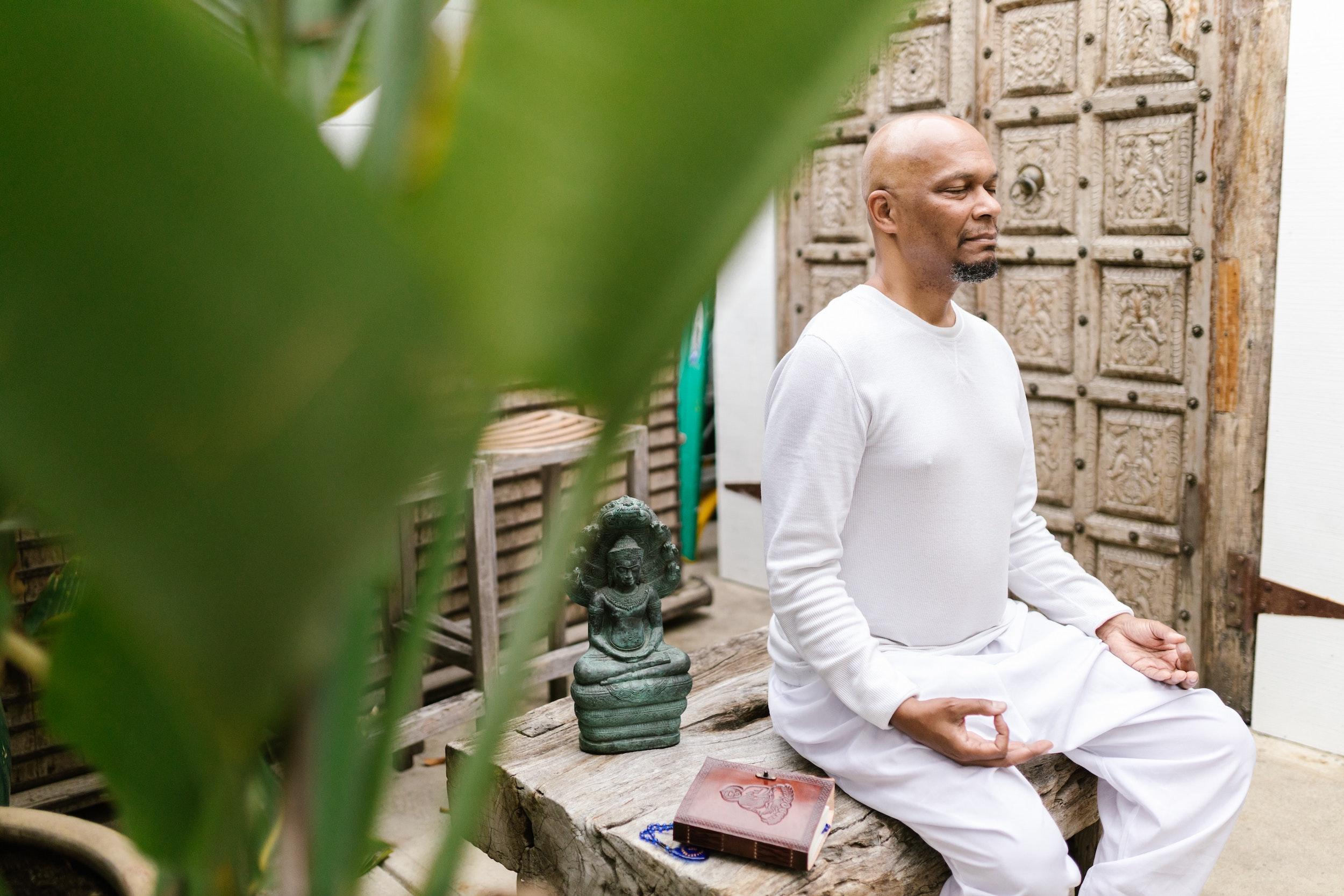 man practicing kundalini yoga